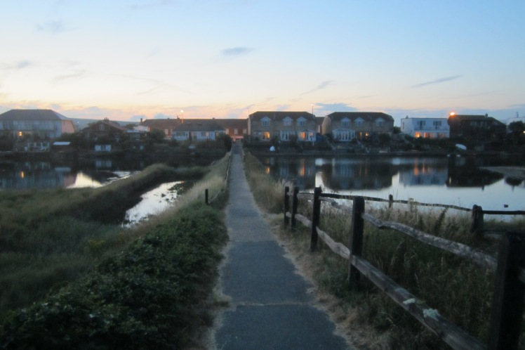 The bridge from the beach, crossing over into Lancing village at dusk.