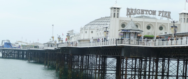Eating chips, looking out onto Brighton Pier.